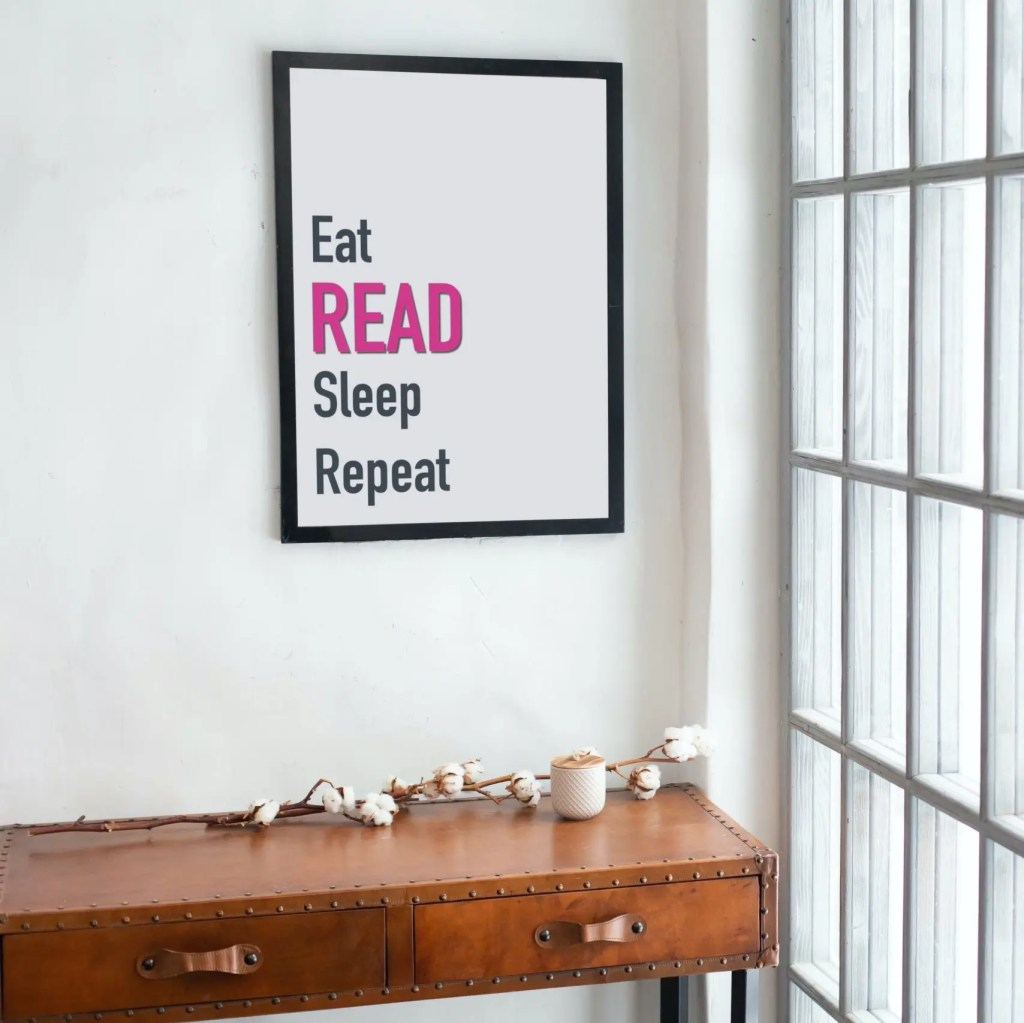 Eat read sleep repeat poster in a black frame