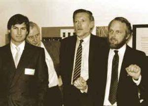 Adobe founders John Warnock and Charles Geschke with Steve Jobs of Apple.