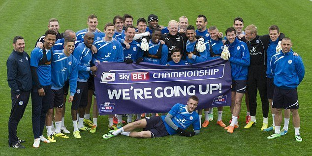 Leicester City players celebrate promotion from the Sky Bet Championship.