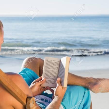 man reading on beach