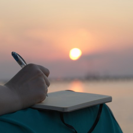 writing at beach