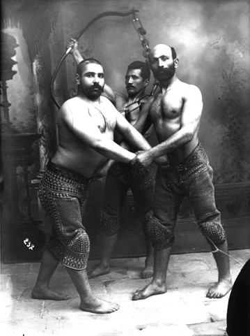 Studio Portrait of Three Traditional Persian Wrestlers