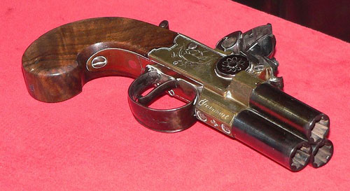 Three barrel pocket pistol capable of firing all barrels simultaneously