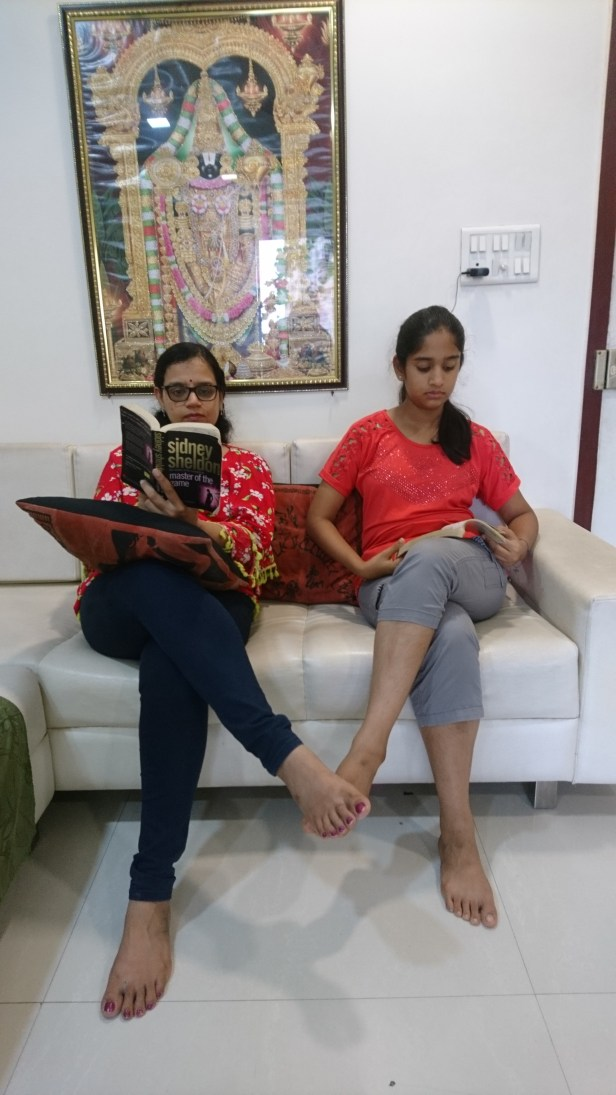 Veena and her daughter engrossed in reading