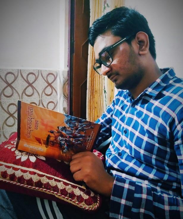 Mayank Srivastava reading the Bhagavad Gita