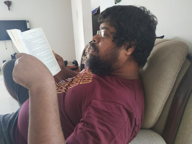 Arnab engrossed in reading a book