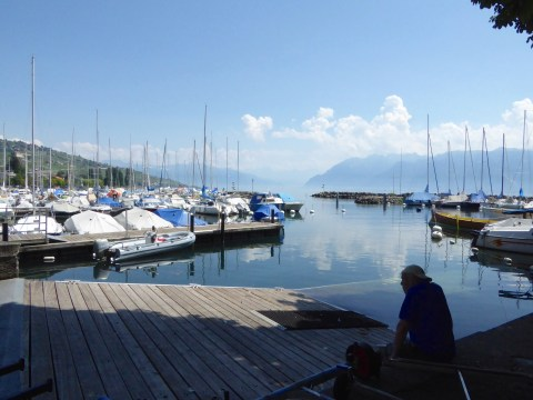 """Photo 46: """"Sitting By the Dock of the Bay"""". Lunchtime in Ouchy."""