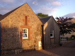 Stone cottage next door in Glencoe village