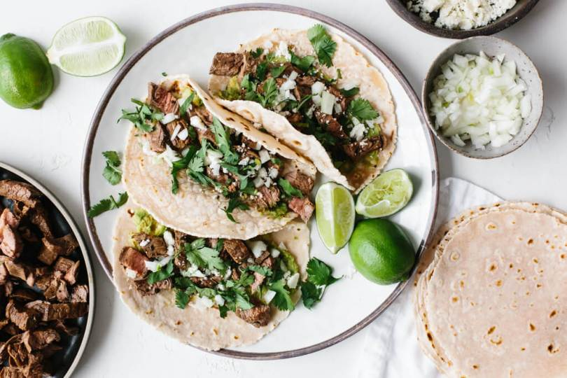 Tacos on a plate with lime