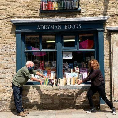 Anne Brichto and Derek Addyman measuring 2 metre distance before re-opening their shop.