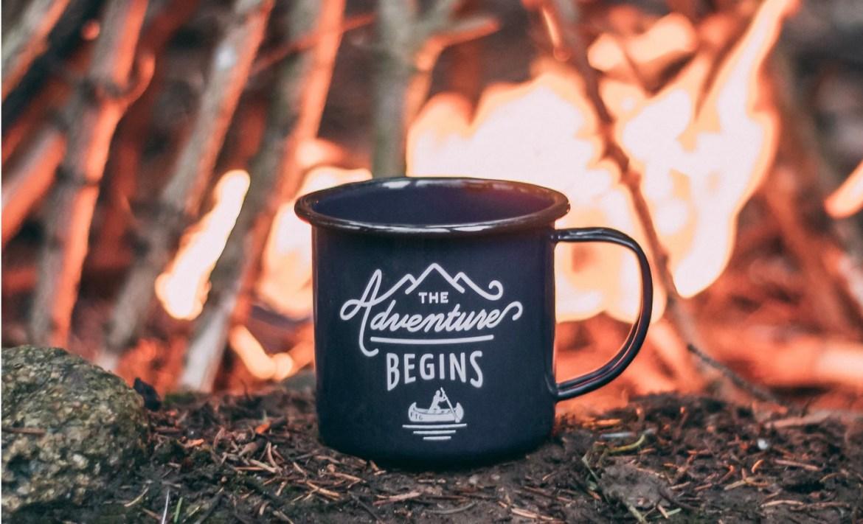 the adventure begins campfire mug
