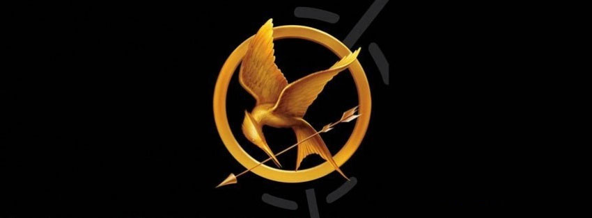 Who gives Katniss her mockingjay pin?