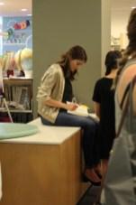Alexandra Bracken ('The Darkest Minds') signs books for fans.