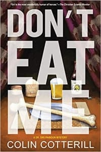 """""""Don't Eat Me"""" by Colin Cotterill (Book cover)"""