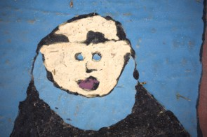 A child's artistic representation of Junípero Serra, underscoring the skewed understanding that school children come away with having gone through the Mission Studies unit in elementary school. (Outside walkway, San Gabriel Mission.)