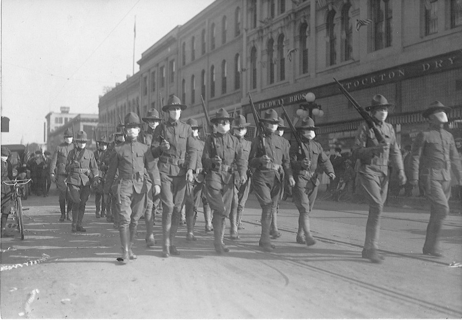 CH_97_03_North_Fig_01-troops-marching-in-masks