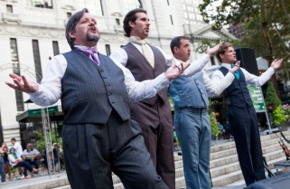 Dan Renkin (l) with the cast of Love's Labour's Lost in Bryant Park