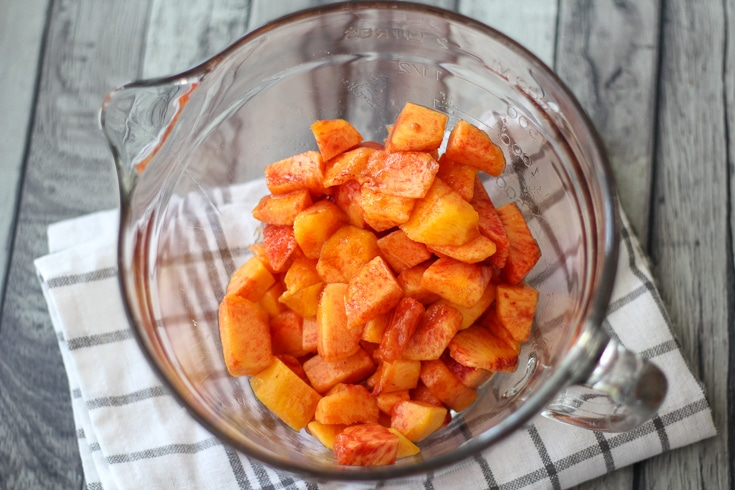 Peeled and chopped peaches in a bowl.