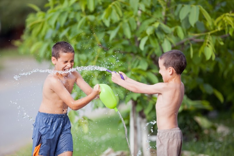 2 boys playing with water balloons