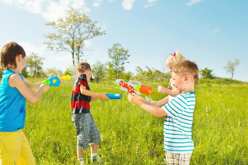 kids playing fun water games with water guns