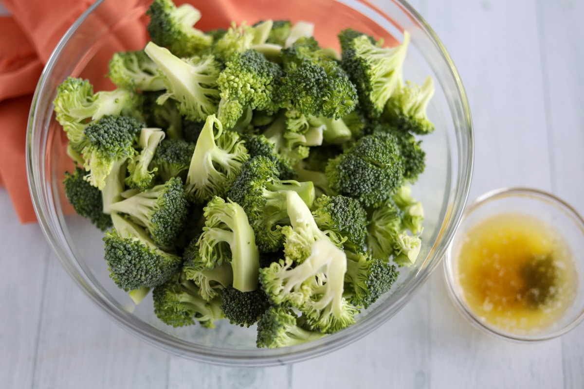 raw broccoli with butter and olive oil mixture