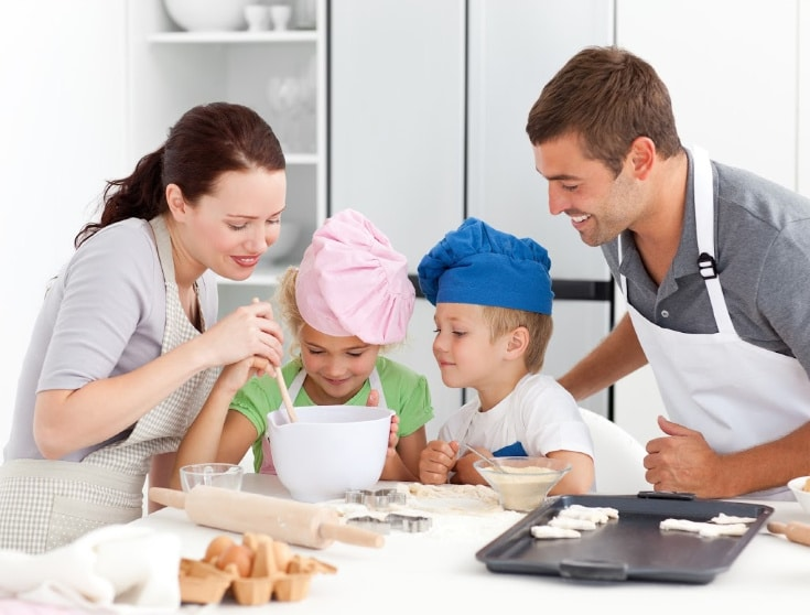a family of 4 making cookies