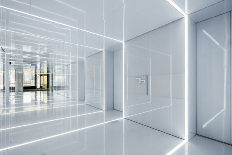 Shanghai studio AIM Architecture has designed the office for Soho China, the property developers behind Zaha Hadid's Galaxy Soho, creating an entrance with reflective strips of light that give the illusion of a never-ending grid | Courtesy Architonic