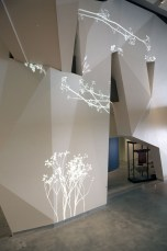 Simon Heijdens' 'Lightweeds' installation moves and behaves in direct dependency on actual sunshine, rainfall and wind, as measured in real time by sensors placed outside the building | Courtesy Architonic