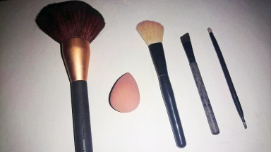 Powder brush, sponge, large angled brush small angled brush, tiny brush for eyeshadow.