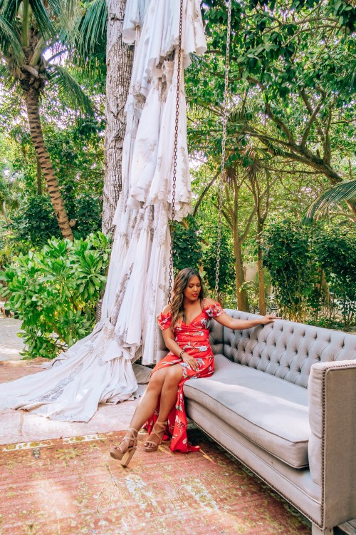 An influencer interview with Lifestyle Instagram influencer Naomi Genota or @naohms on Instagram who is sitting on a swing in Tulum here