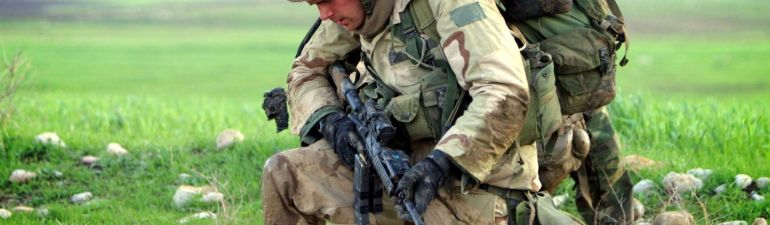 Soldier carrying heavy load