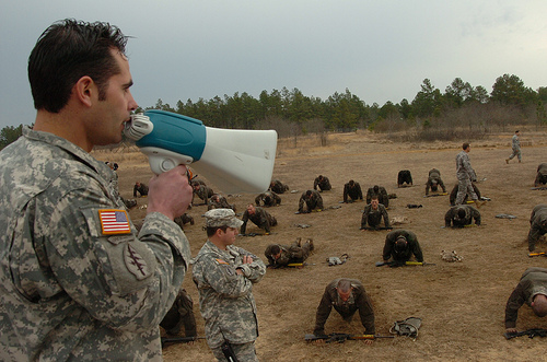 Staff on the US Army's 'Q' course providing some feedback and encouragement to candidates.