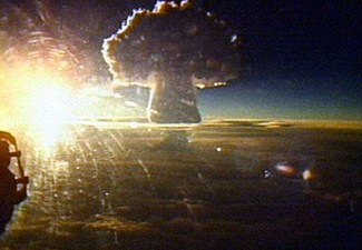 The mushroom cloud of Tsar Bomba seen from a distance of 161 km (100 mi). The crown of the cloud is 65 km (40 mi) (213,000 feet) high at the time of the picture.