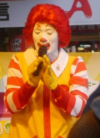 Ronald McDonald was speaking Chinese to children across the street from an nuclear power protest