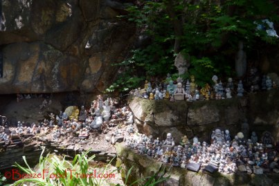 Various Buddhas left by travelers from around the world at the temple at Achasan