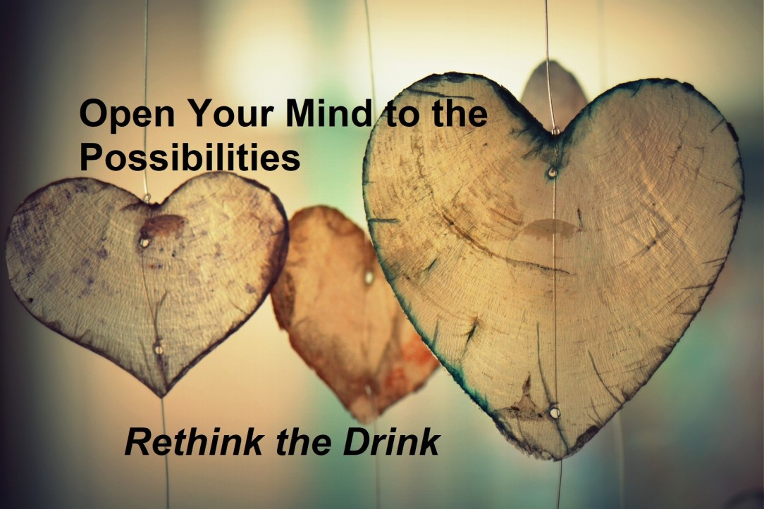Hearts made out of wood with text reading open your mind to the possibilities being sober, Rethink the drink
