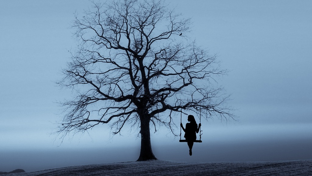 woman on swing in tree, inspiration to stop drinking  and enjoy life more