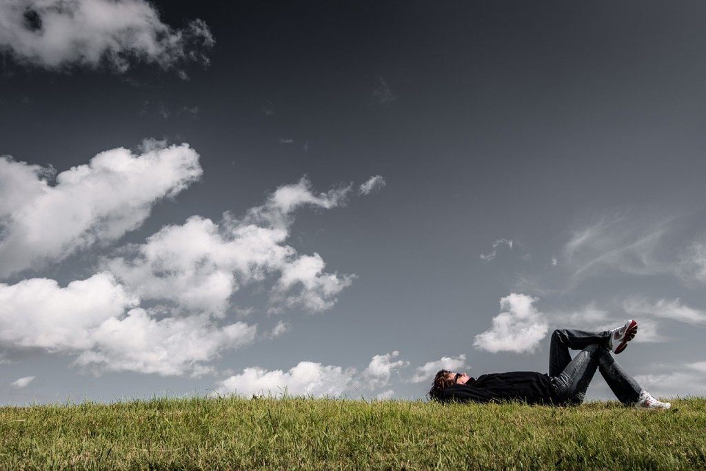 Person looking at clouds relaxed
