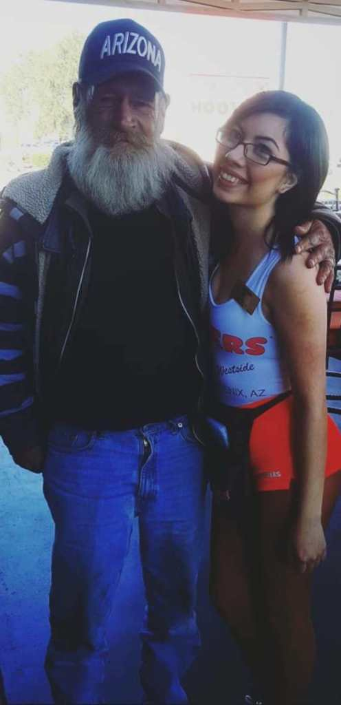 Hooters Waitress Poses With A Stranger. Seconds Later, He Pulls THIS Off His Neck...