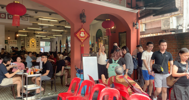 People waiting in line to eat at Yut Kee in Kuala Lumpur