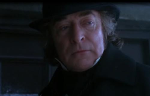 Michael Caine as Ebenezer Scrooge