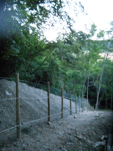 This new fence line, with a large ditch dug above it, will hopefully be less vulnerable to falling rocks which have typically created an annual maintenance headache.
