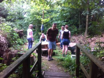 """No rest for the weary. One of my favorite parts of the Quaker YALP retreat was building a """"ephemeral sculpture"""" on the grounds of Woodbrooke with fallen tree rounds."""
