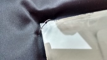 A detail of a wire that holds the plate.