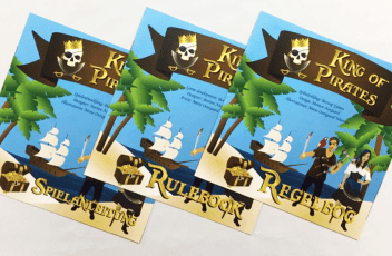 Borzag Games rulebooks for King of Pirates in english, german and danish