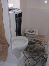 Testing the toilet fit ... it fits!