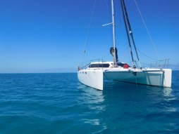 Bossa Nova safely at anchor avoiding the coral bommies on the bottom.