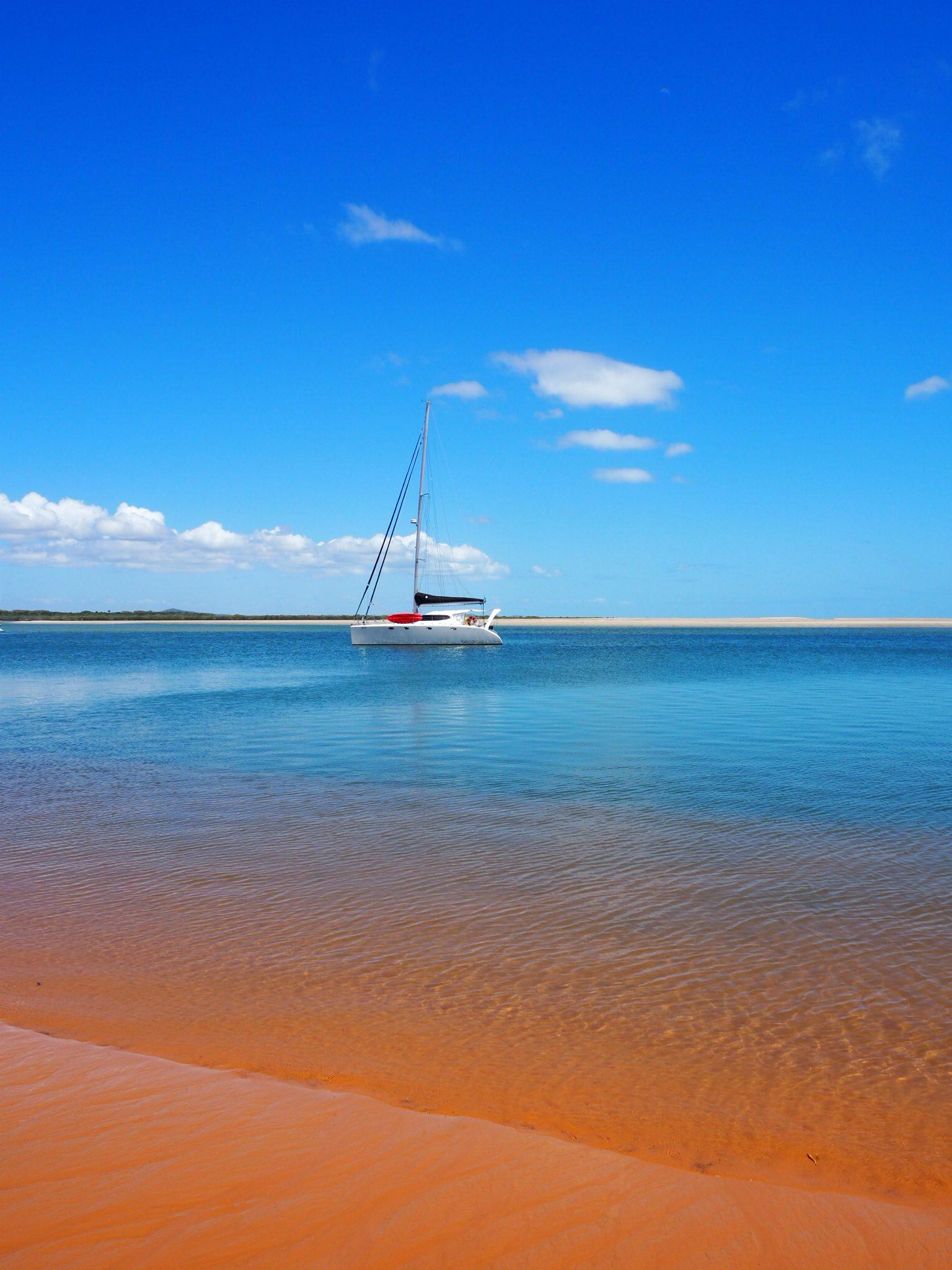 The water's edge sand was orange!