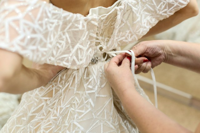 Getting dressed in a wedding dress