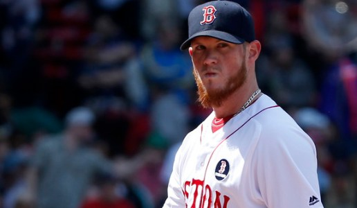 Boston Red Sox pitcher Craig Kimbrel (46) reacts as he returns to the dugout after giving up three runs during the eighth inning of a baseball game against the Toronto Blue Jays at Fenway Park, Monday, April 18, 2016, in Boston. (AP Photo/Mary Schwalm)